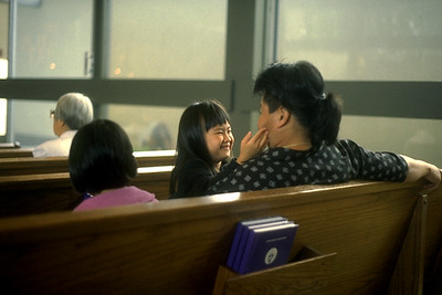 A Mother Smiles at Her Daughter During a Service at Senshin Temple (Los Angeles, CA)