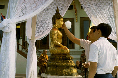 Placing Gold Leaf on a Buddha Statue During Songkran New Year's Celebration (North Hollywood, CA)