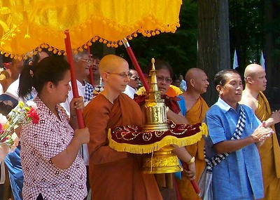 Venerable Sudhamma Bhikkhuni Caries a Buddhist Relic at an Inauguration Celebration at Wat Lao Buddharam Temple (Charlotte, NC)