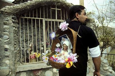 Pilgrim at Chimayó Carrying an Icon (Santa Fe, NM)