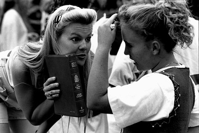 Christians Discussing while Holding a Bible