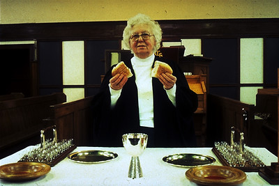 Pastor Breaks Bread at the Lord's Supper