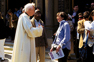 Priest Greeting Congregants (Cambridge, MA)