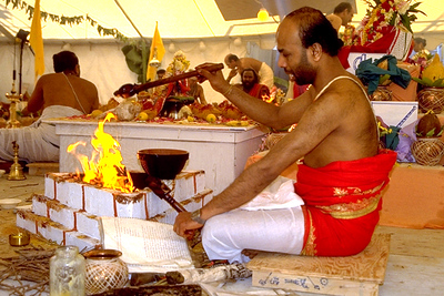 Priest Makes a Ghee Offering in the Fire at Sri Lakshmi Temple Consecration (Ashland, MA)