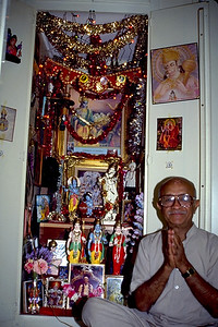 Man Sits by His Home Altar (Southern California)