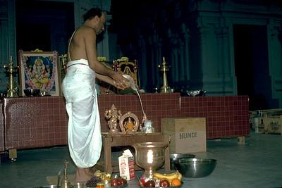Hindu Priest Bathes a Murti With Milk (Ashland, MA)