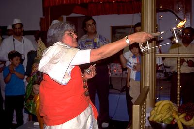 Woman Makes Arati Lamp Offering to Lord Hanuman (Hempstead, NY)