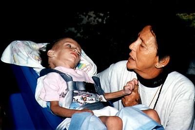 Ma Jaya and a Child With AIDS at the Kashi Ashram (Roseland, FL)