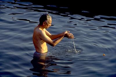 Hindu Man Bathing in the River Ganges (Banaras, India)
