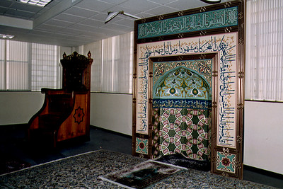 A Minbar Near a Mihrab Featuring Ornate Calligraphy (Jamaica, NY)