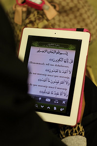 A Young Girl Follows Along with Qur'anic Recitation During Ramadan (Charlotte, NC)(Charlotte, NC)