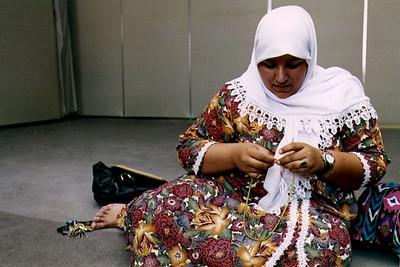 Woman Praying with a Masbaha (Jamaica, NY)