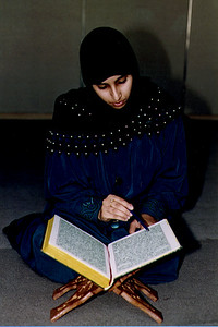 Woman Engaged in Devotional Reading of the Qur'an (Jamaica, NY)