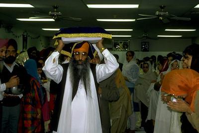 Granthi Carrying the Guru Granth Sahib (Fairfax, VA)