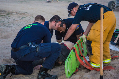 Station 53 fire fighters working on a patient after a off road accident.(By Brandon Barsugli)