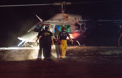 BP53, MA53 and Mercy Air crew moving Patient to helicopter.(By Brandon Barsugli)