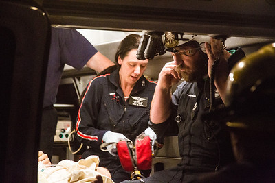 Mercy Air crew prepping patient for ride to hospital(By Brandon Barsugli)