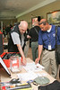 <b>IMG_68173</b><br>Conference attendees check out the display from PennCamera