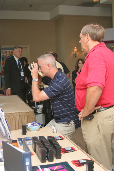 <b>IMG_68171</b><br>Rick Larson (right) from LaserCraft discusses his products with a conference attendee