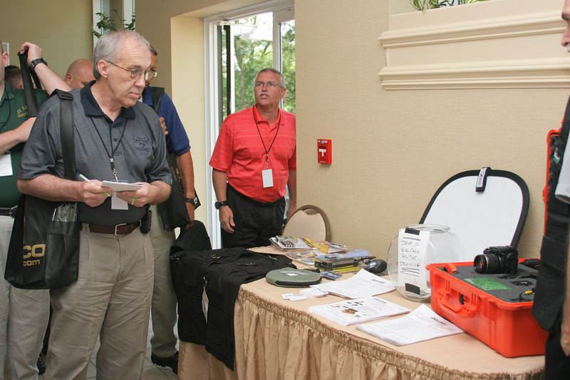 <b>IMG_68172</b><br>Conference attendees check out the display from PennCamera