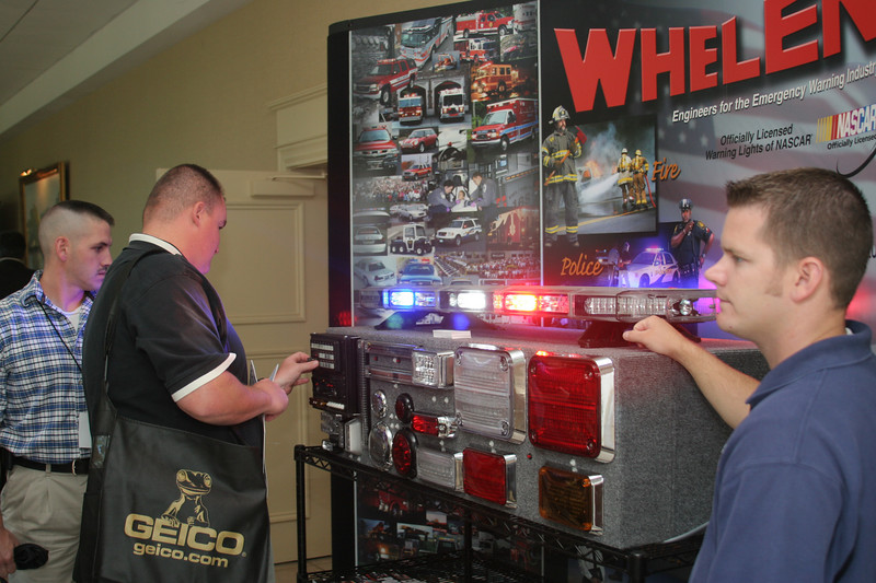 <b>IMG_68178</b><br>Attendees visit the Whelen Electronics booth
