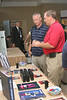 <b>IMG_68170</b><br>Rick Larson (right) from LaserCraft discusses his products with a conference attendee
