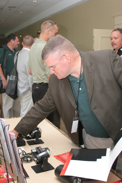 <b>IMG_68176</b><br>Officer Clay Seamster, Smithfield Police Department, visits the Decatur Electronics booth