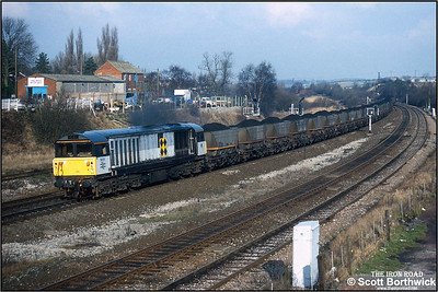 58011 passes Clay Cross Jnct with a southbound MGR coal train on 01/02/1993.