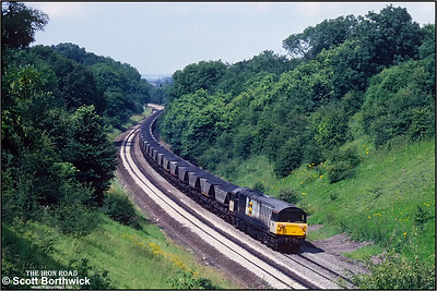 58025 passes through Harbury cutting whilst working 7V33 1108 Barrow Hill SS-Didcot Power Station on 01/08/1991