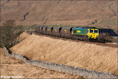 66564 powers 6E73 0608 Hunterston-Ferrybridge Power Station through Ribblehead on 21/01/2006.