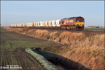 66110 approaches Middle Drove LC near March on 22/01/2005 with a rake of LaFarge PGA hoppers forming 6L38 0729 SO Mountsorrel Sdgs-Broxbourne.