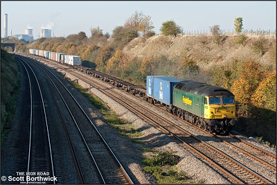 With the leaves displaying their autumn colours, 57002 'Freightliner Phoenix' powers through South Moreton cutting with 4O27 0524 Trafford Park-Southampton MCT on 27/10/2005 .