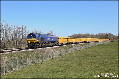 66791 passes Rearsby whilst working 6M60 1107 Whitemoor Yard LDC-Mountsorrel Sdgs on 22/04/2021. The locomotive sports the remains of its Beacon Rail livery from when it operated in Sweden with GBRF only applying branding rather than a complete relivery.