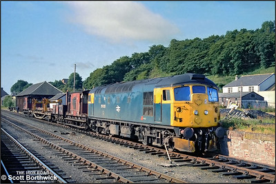 26032 stands at Dingwall prior to running round its short Inverness bound PW train on 21/07/1983.