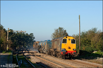 20312 & 20309 top and tail 1Z61 0845 Stowmarket-Norwich Trowse Yard railhead treatment train (RHTT) at Thetford on 04/11/2006.
