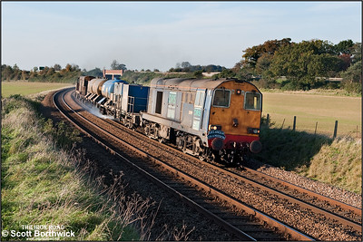 The water cannons are on as 20309/20312 top & tail 1Z63 1310 Wymondham-Colchester 'Leafbuster' at Seven Mile Bridge, Higham on 04/11/2006.