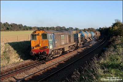 20312 brings up the rear of 1Z63 1310 Wymondham-Colchester 'Leafbuster' which was headed by 20309 at Seven Mile Bridge, Higham on 04/11/2006.