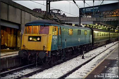 83015 stands at London Euston awaiting the road with the ECS off an overnight sleeper service on 19/1/1987.