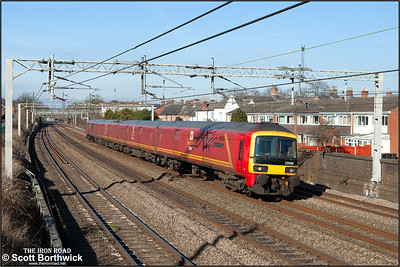 325008 forms 5A91 1120 MO Crewe Electric TMD-Willesden PRDC passing Atherstone on 09/02/2015.