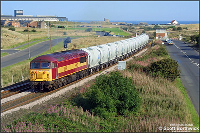 56119 is seen passing Freemans Crossing with 6N69 1524 North Blyth-Lynemouth on 11/09/2002.