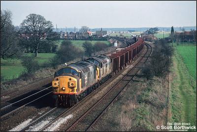37351+37250 pass Knabbs Bridge, Melton Ross whilst working 6T26 1233 Immingham Ore Terminal-Santon on 06/03/1992.