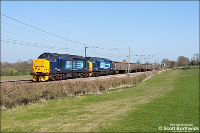 37667+37510 pass Church Lawford whilst working 6Z70 1008 Sheerness Steel Works-Tyne Dock on 17/04/2010.