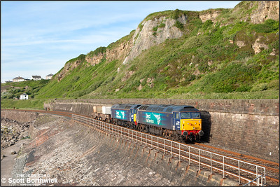 57003+57007 skirt Tanyard Bay, Parton whilst working 6M22 1217 Hunterston Low Level DRS-Sellafield BNF on 23/06/2016.