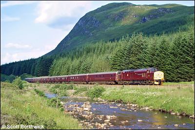 37401 'The Royal Scotsman' hauls 1H90 1407 Edinburgh Waverley-Taynuilt 'Royal Scotsman' through Glen Lochy on 04/08/2002.