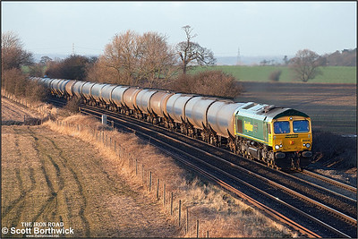 66618 catches some golden winter sunshine at Portway on 18/02/2005 whilst in charge of 6M00 1123 Humber Oil Refinery-Kingsbury Oil Sdgs. The train had been sitting in the loop at Elford for an hour awaiting 6E59 to clear the sdgs at Kingsbury allowing a heavy rain shower to pass and the sun to come out.