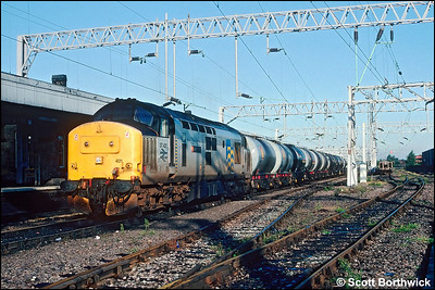 37421 'Strombidae' stands at Nuneaton whilst working 6D18 0457 MThO Stanlow Shell Sep Sdgs-Derby Etches Park CS on 30/09/1991.