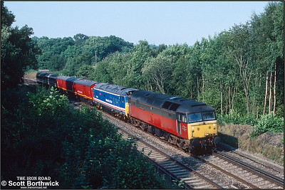 47522 'Doncaster Enterprise' passes Balcombe on 21/09/1991 hauling 50035 'Ark Royal' and an assortment of coaching stock from Old Oak Common to Brighton Lovers' Walk TMD for the following days open day in connection with the Brighton Line 150 celebrations. 50035 was on route to St. Leonards Railway Engineering Ltd via the open day.