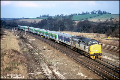 37422 drags brand new 323204+323203 south at Clay Cross on 01/02/1993. The train was running from RFS Kilnhurst to Kineton for the units to be securely stored prior to introduction to operating service, however it only ran as far as Derby due to braking problems.