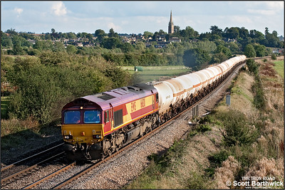 66130 passes Kings Sutton on 20/09/2005 with 6Z18 1351 Eastleigh East NY-Stoke Marcroft. The train conveyed LPG tanks formerley used on the Furzebrook-Hallen Marsh circuit for scrapping.