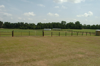 Looking northeast from the parking corral. Gates in the foreground can be used to separate in/out traffic. Buildings in the center belong to the Seminole RC Club. Cross country course begins off-screen to the left, runs east along the treeline before turning northward.